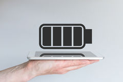 Concept of battery life for mobile devices. Hand holding modern smart phone Stock Images