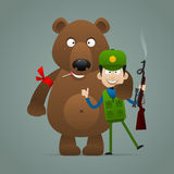 Concept bear holds hunter and smiling Stock Image