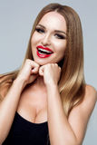 The concept of a beautiful smile, dentistry. Beauty, fashion, style. Beauty portrait of stylish young woman enjoys Stock Photos