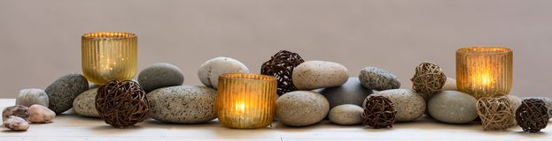 Concept of beauty, peace, spirituality, mindfulness or alternative medicine. With mineral pebbles and candles, panoramic still life stock photography