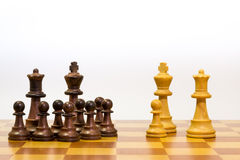 Concept of big family with different ethnicity. With pawns of chess Royalty Free Stock Photos