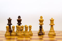 Concept of big family with different ethnicity. With pawns of chess Stock Photos
