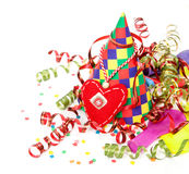 Concept birthday celebration - a hat and serpentine Royalty Free Stock Images