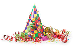 Concept birthday celebration - a hat and serpentine Royalty Free Stock Image