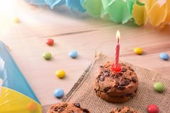 Concept of birthday table with sweets and candle elevated royalty free stock photo