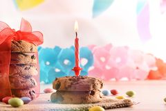 Concept of birthday table with sweets and candle vertical royalty free stock photo