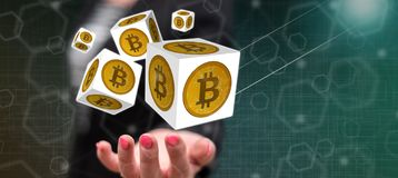 Concept of bitcoin. Bitcoin concept above the hand of a woman in background royalty free stock photography