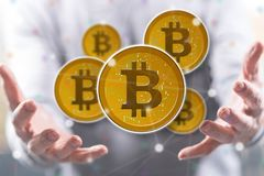 Concept of bitcoin. Bitcoin concept above the hands of a man in background royalty free stock images