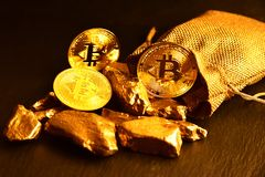 Concept of bitcoin coins and gold stones. Close-up. Concept of bitcoin coins and gold stones. Close-up royalty free stock photos