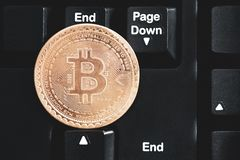 Concept bitcoin cryptocurrency virtual cash. btc coin lays at black keyboard. rip bitcoin collage. toned matte. dramatic light. lo. W exchange rates trend. for stock images