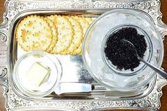 Concept with black caviar Royalty Free Stock Photos