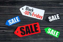 Concept black friday on dark wooden background top view.  Royalty Free Stock Images