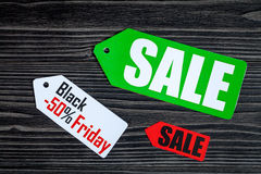 Concept black friday on dark wooden background top view.  Royalty Free Stock Photos