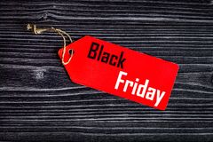 Concept black friday on dark wooden background top view Stock Photos