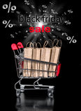Concept of black friday shopping cart with paper bags percent is Stock Image