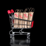 Concept of black friday shopping cart with paper bags percent is Stock Photo