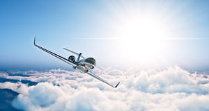 Concept of black luxury generic design private jet flying in blue sky at sunset. Huge white clouds background. Business. Travel photo. Horizontal , angle view royalty free stock photography