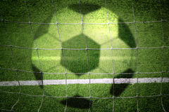 Concept blurred soccer ball and net background Stock Images