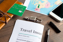 Concept booking travel insurance on wooden background Royalty Free Stock Photo