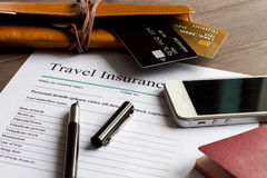 Concept booking travel insurance on wooden background stock photo