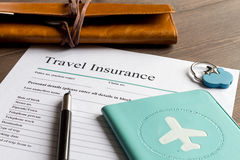 Concept booking travel insurance on wooden background. Close up stock photo
