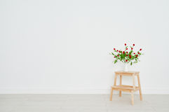 Concept of  bouquet of flowers on  stepladder on background whit Royalty Free Stock Images