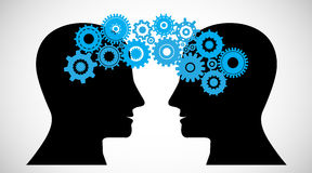 Concept of Brain storming, Knowledge sharing between to people head, this was shown through cogwheels Stock Photos