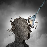 Concept Of Brainstorming. And racking your brains idea as a human head made of cement or concrete being demolished by an illuminated lightbulb or light bulb as Stock Image