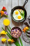 Concept of breakfast with spring mood, oatmeal and fried eggs Stock Photos