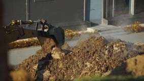 Concept of the breakthrough of underground utilities. Steam breaks out of the ground. Excavator digs a hole to determine. The location of the breakthrough of stock video