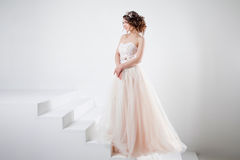 Concept of bride going towards future happiness. Portrait of a beautiful girl in a wedding dress. Royalty Free Stock Images