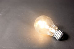 Concept of bright idea with series of light bulbs stock photo