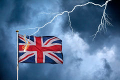Concept of the British Brexit with the English flag struck by li. Ghtning in a heavy storm stock images