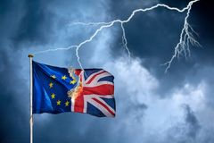Concept of the British Brexit with the English flag struck by li Royalty Free Stock Photos