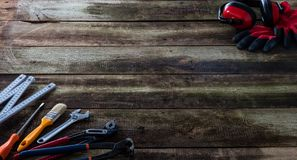 Concept of building or DIY tooling on wooden maintenance board. Concept of building or DIY tooling on old wooden house maintenance board with folding meter stock image