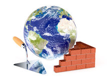 Concept of building, Elements of this image furnished by NASA. Brick wall with a big trowel and a world globe, concept of building (3d render) Elements of this Stock Photography
