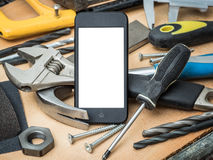 A concept with building tools and a smartphone for posting your idea Royalty Free Stock Photography