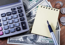 Concept - business.Calculator, money, notebook Royalty Free Stock Image
