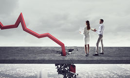 Concept of business collapse . Mixed media Stock Images