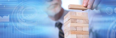 Concept of business development. panoramic banner. Business development concept by building a tower with domino blocks. panoramic banner stock photo
