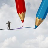 Concept Of Business Direction. As a businessman walking on a highwire drawn by two pencils as a crossroad challenge to choose the correct path or pathway to Stock Image