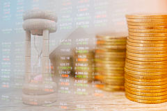 Concept business and finance. stack of coins and clock hands. idea of time value of money. The present money for time same amount in the future Stock Photography