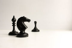 Concept of business game. Chess piece. S on white background. Photo for your design royalty free stock images