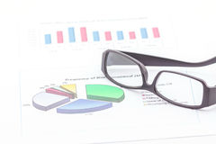 Concept of business graph and glasses. Stock Photos