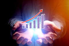 Concept of business graph icon flying out man`s hand - technolog. Concept view of business graph icon flying out man`s hand - technology concept Stock Image