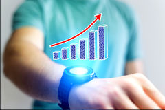 Concept of business graph icon flying out a smartwatch - technol Royalty Free Stock Photography