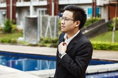 Concept Business - Handsome asian Business man ready to go for w Stock Photos