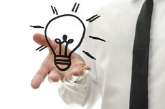 Concept of business innovation. Male hand presenting a light bulb drawn on a virtual whiteboard. Concept of business innovation Royalty Free Stock Photography