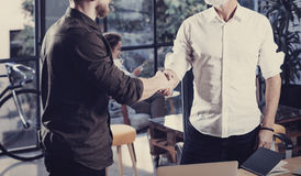 Concept of business partnership handshake.Closeup photo two businessmans handshaking process.Successful deal after great Royalty Free Stock Image