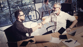 Concept of business partnership handshake.Photo two bearded businessmans handshaking process.Successful deal after great Royalty Free Stock Photography